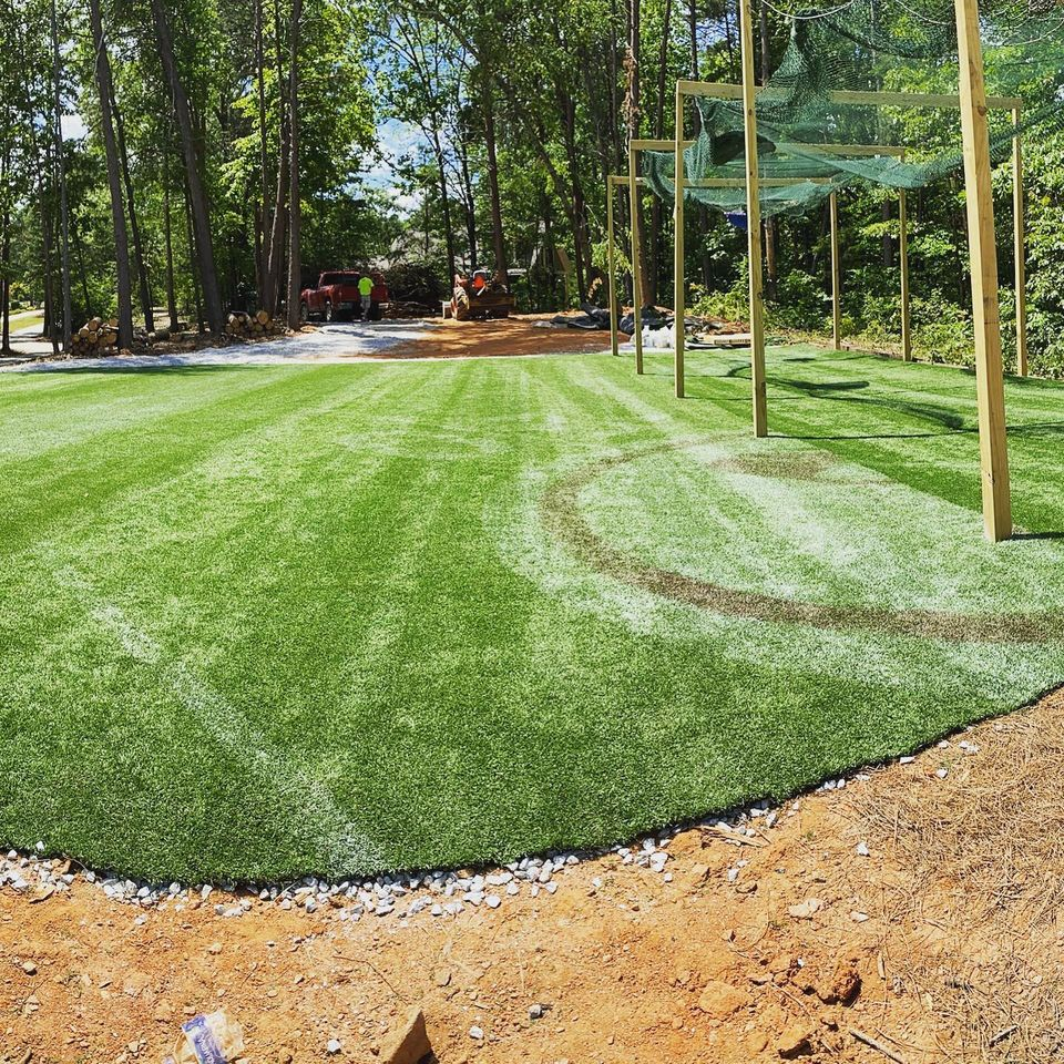 This is used artificial turf being utilized as a sportsfield in a backyard.