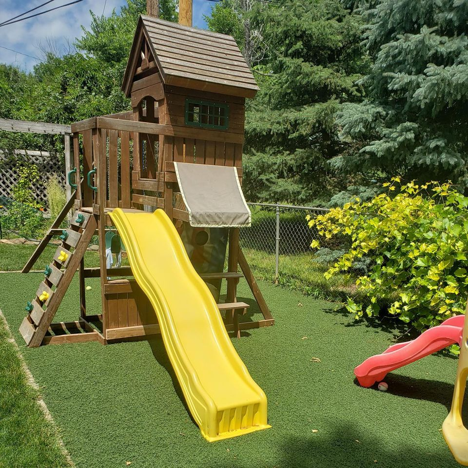 Used artificial turf being utilized as a playground floor.