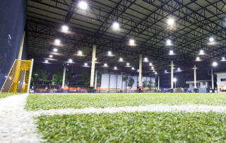 a soccer field utilizing used artificial turf for indoor sports