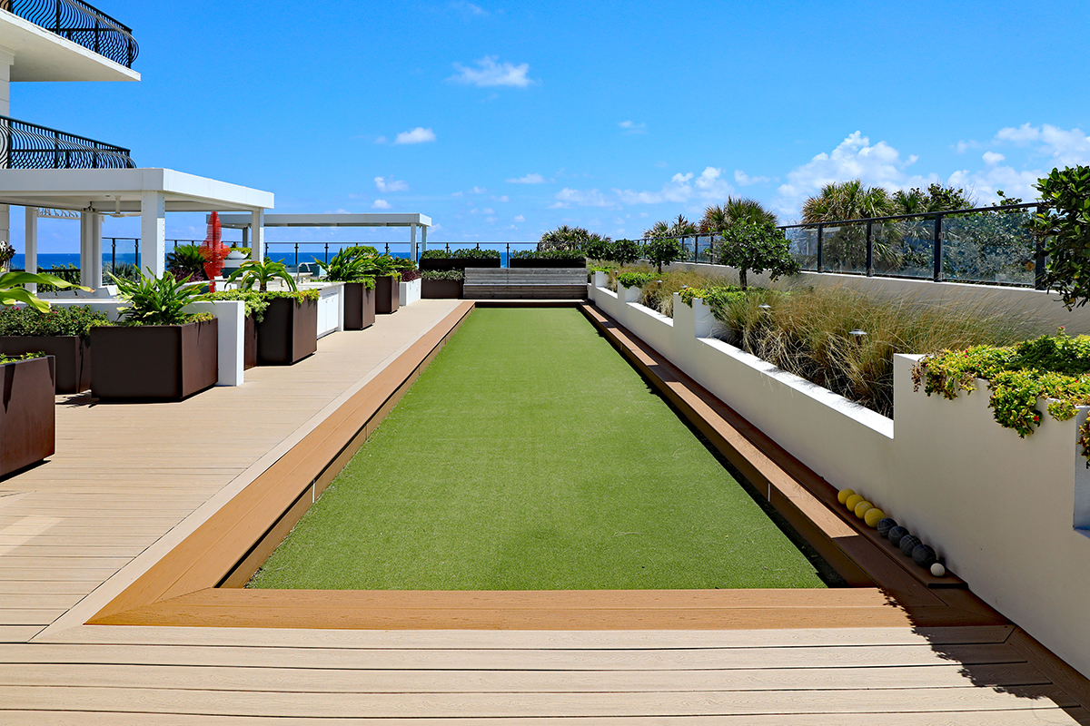 Inviting upscale bocce ball court with artificial turf, on a roof