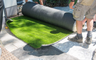 professional gardeners are rolling out artificial turf