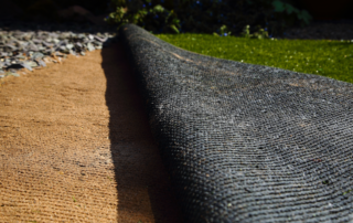 recycled artificial turf being installed